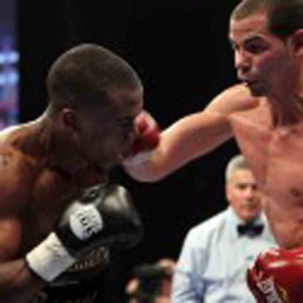 Abril Retains WBA Title, Russell Wins